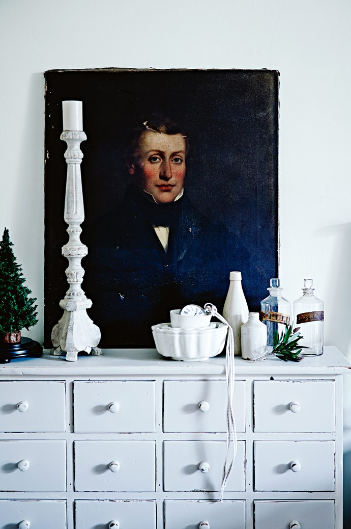 An early colonial portrait, artist unknown, rests on a spice cabinet painted with Dulux Barnfloor, with a candlestick from The Vintage Rose.
