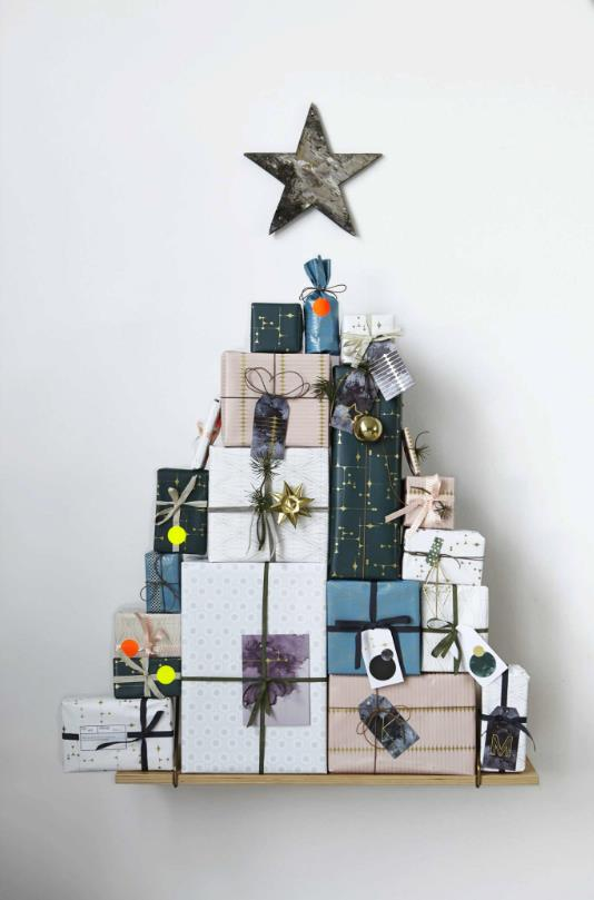 "Presenting our favourite alternate tree - made of presents! Stack gift boxes of varying shapes and sizes on top of each other for a gorgeous display. Photo: [Lesley Graham](https://www.lesleywgraham.com/|target=""_blank""