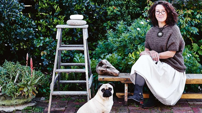 For Carmen, who has spent the past 30 years in country towns in Queensland and Tasmania with her marine biologist husband, Peter, the small cottage, with views over Hobart's suburbs and that enchanting light enhanced by renovation, is as close to the country as it gets in the city. | Photo: Lisa Cohen