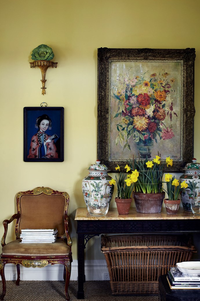 Daffodils in terracotta pots adorn a console table in the living room.