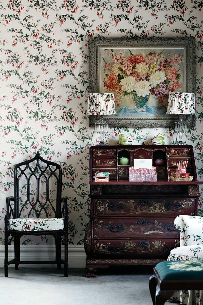 "An antique bureau takes centre stage amongst a sea of floral wallpaper and textiles in one of the upstairs bedrooms. Wallpaper and fabric in 'Fuscia' by [Colefax and Fowler](http://designs.colefax.com/Design/01070-01|target=""_blank""