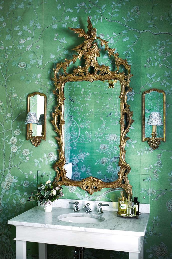 "A gilded mirror alongside a pair of matching wall sconces makes for a striking vignette against [botanical wallpaper](https://www.homestolove.com.au/botanical-wallpaper-trend-19192|target=""_blank"")."