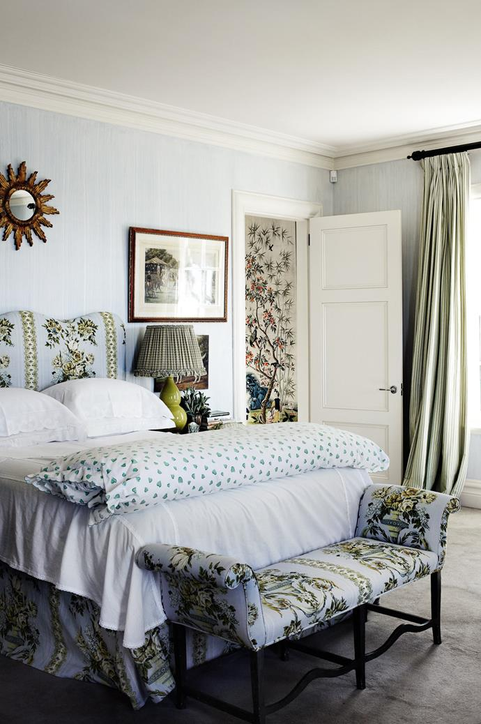 A more subdued approach to patterns and florals has been taken in the main bedroom. Here, calming blue wallpaper sets the scene for a restful night's sleep.