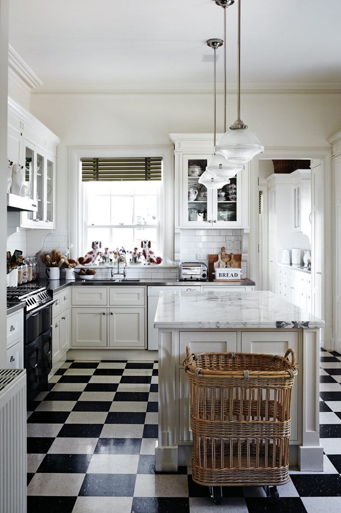 "The [classic country kitchen](https://www.homestolove.com.au/country-kitchen-design-ideas-13266|target=""_blank"") with shaker cabinets, marble island bench and chequerboard flooring."