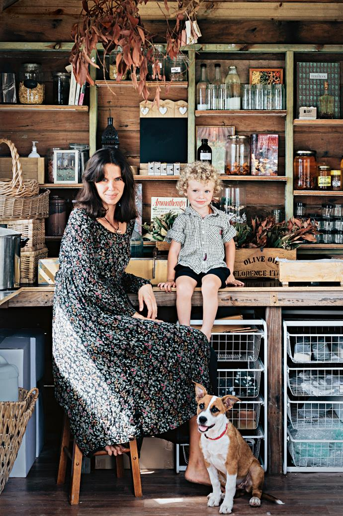 Amanda in her studio with son Banjo and dog Maggie.