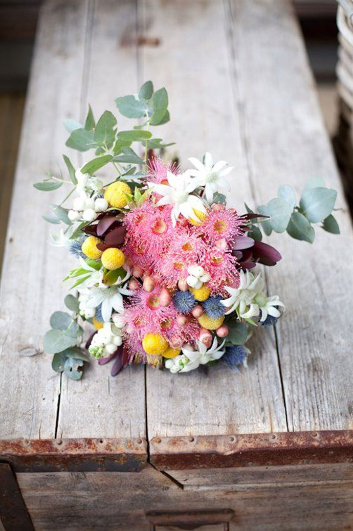 2\. Gum blossom, flannel flowers and billy buttons. One of our favourite natives, billy buttons, represent good health while flannel flowers are symbolic of grace under pressure all brought together by pink gum blossom. Image courtesy of [Good Company](https://au.pinterest.com/source/good-company.com.au/).