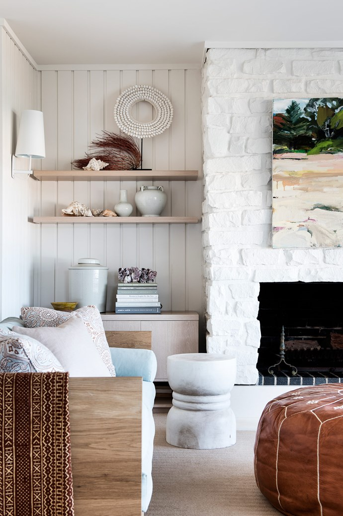 """The home is filled with unique touches that make it truly one-of-a-kind. The brickwork around the fireplace, for example, is an original feature that Karen painted over. """"The white paint brings it into the 21st century, and makes the fireplace look like it really belongs in the house,"""" she says. 