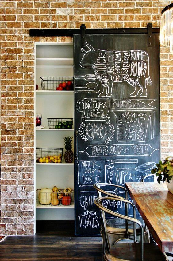 This sliding barn door doubles as a message board in this rustic dining room.