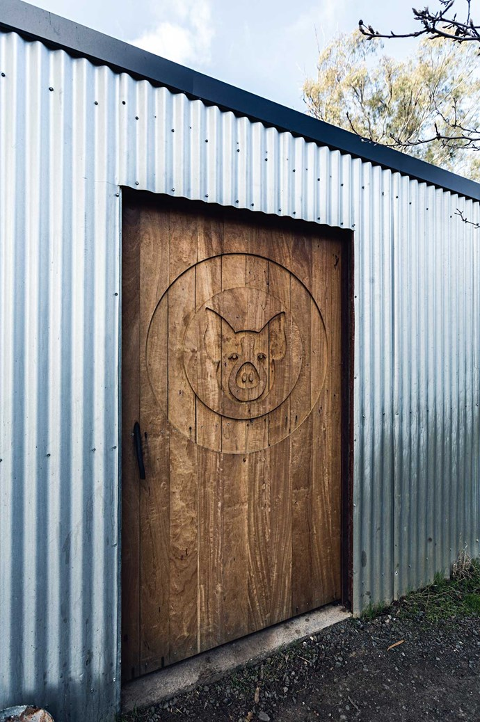 A timber door brandished with the Bundarra Berkshires logo.