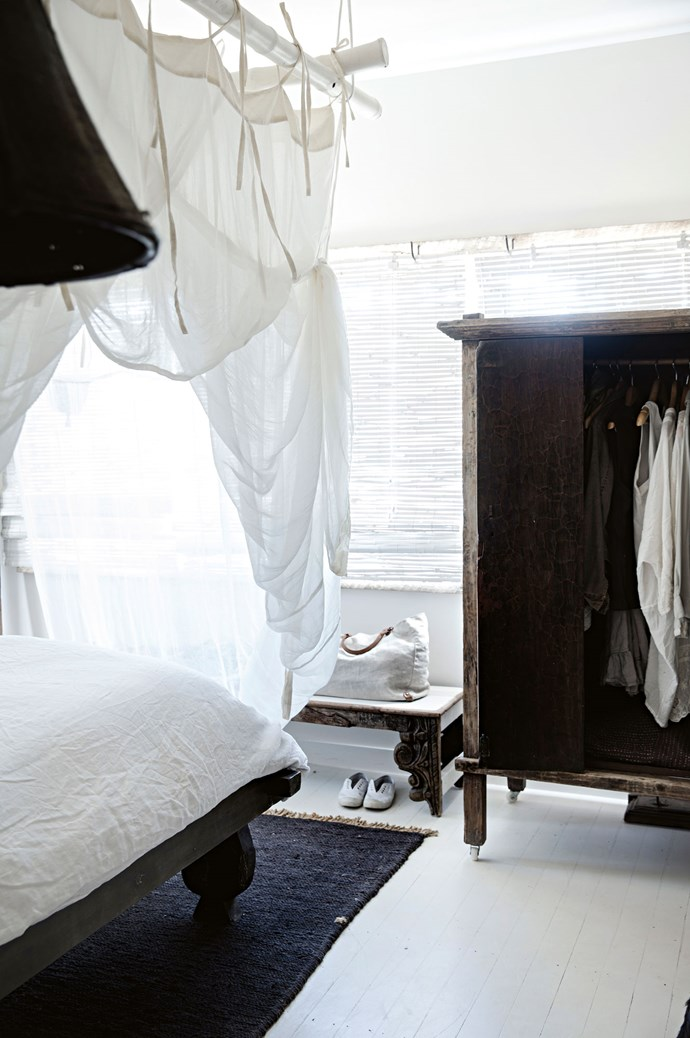 """A Javanese kitchen cupboard is used as a wardrobe in the master bedroom, alongside a rug from [Armadillo & Co.](https://armadillo-co.com