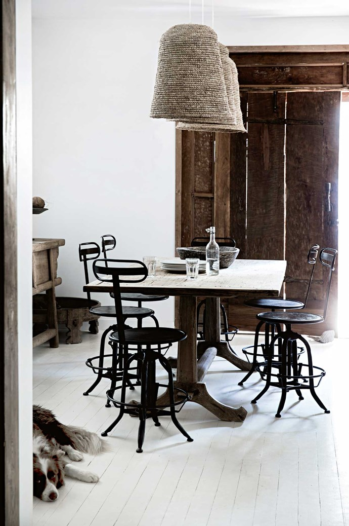 A Javanese table is matched with iron chairs Heidi has custom-made and -tinted in India.
