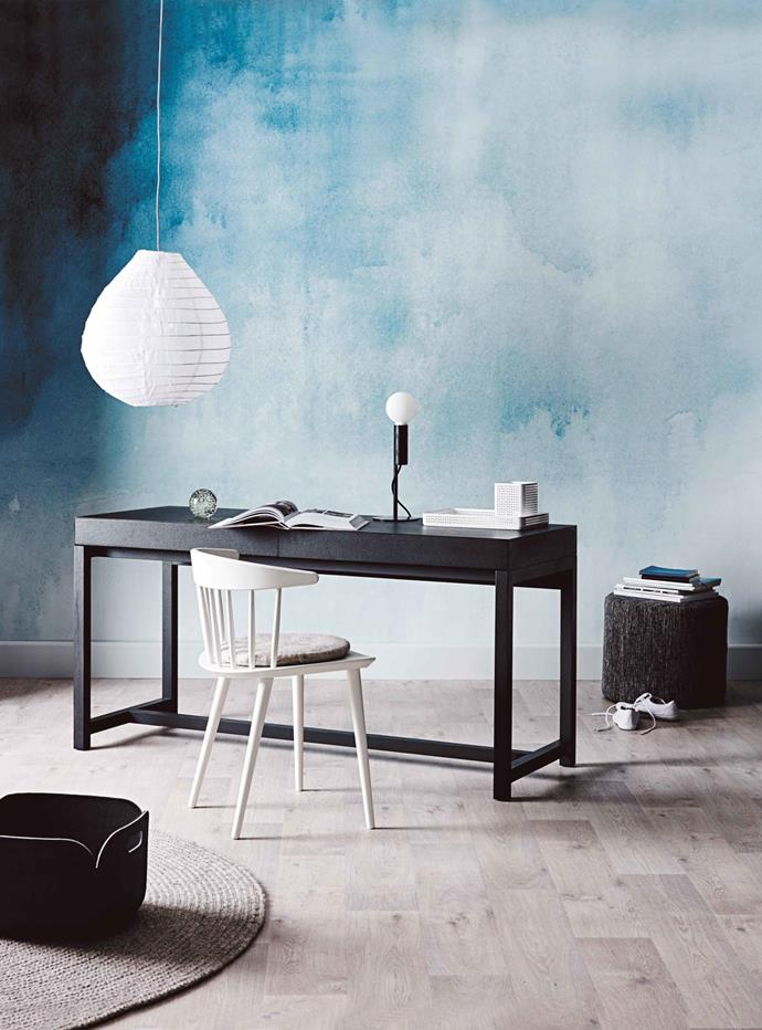 You can still have fun when decorating a minimalist space. A watercolour mural lightens the mood in this monochrome space without making the room feel too busy.