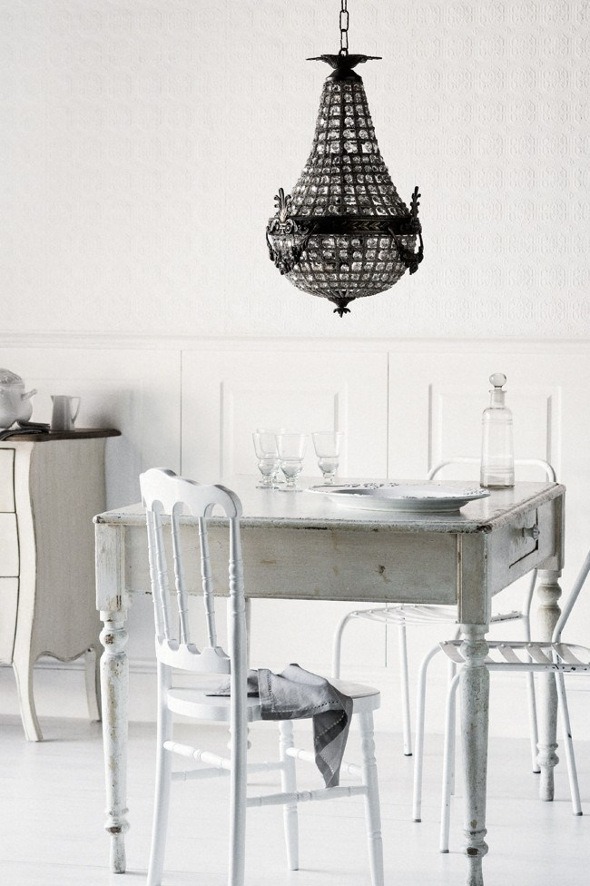 A chandelier adds glamour to a basic kitchen setting   | Photo: Sam McAdam-Cooper