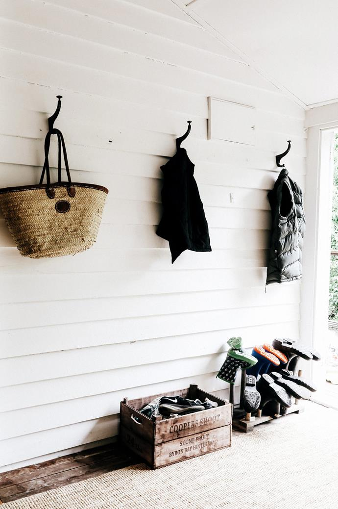 Hooks and clever shoe storage are positioned conveniently at the entrance of the home.