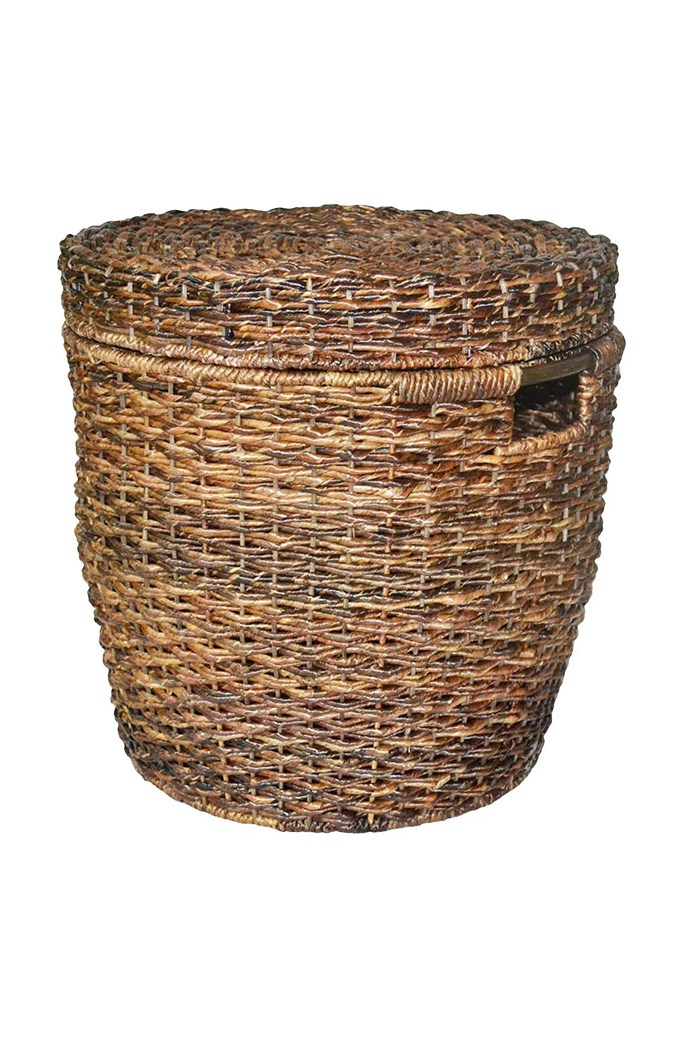 """Wicker Lidded Round Storage Basket, $51.99, from [Target](http://www.target.com/p/wicker-lidded-round-storage-basket-dark-global-brown-threshold/-/A-14758461). """"I bought one for my family room to keep blankets in, and was so pleased I bought another for the basement!"""" one review read."""