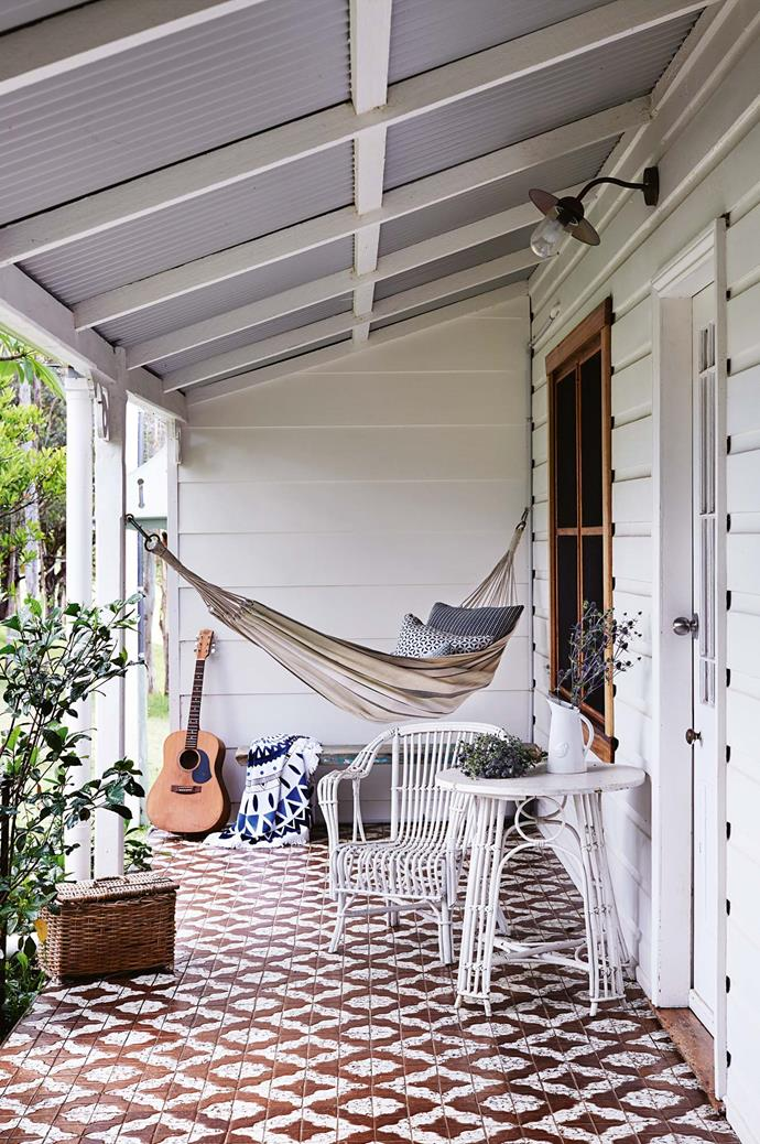 "A canvas hammock welcomes guests to the cottage-turned-gallery, with cushions from [Walter G](https://walter-g.com.au/|target=""_blank""