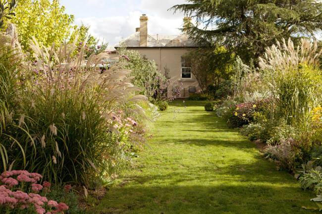 """The view from the summerhouse back to the main building. """"The garden is full of grasses, sedums and dahlias,"""" Simon explains.   Photo: Simon Griffiths"""