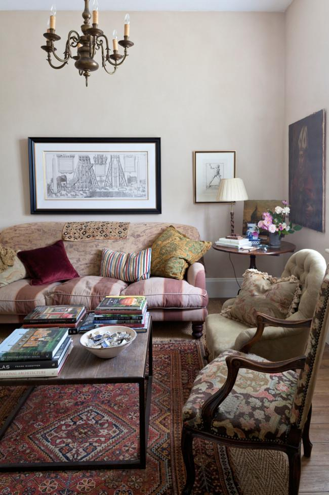 Engravings purchased in Italy and a large chandelier from Tasmania in the sitting room whose sofa and chairs were bought at auction.   Photo: Simon Griffiths