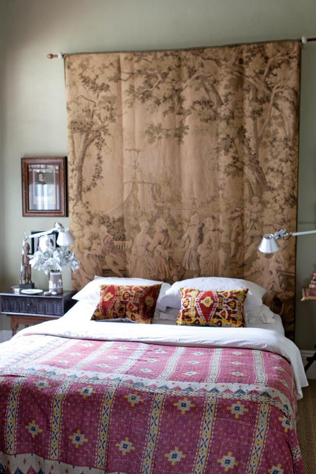 An early 20th-century Belgian tapestry bought at action by Ian hangs in the bedroom. The silk velvet cushions are from [Kabinett Vintage](http://www.kabinett.com.au/) in Kyneton, as is the antique Indian bedspread.   Photo: Simon Griffiths