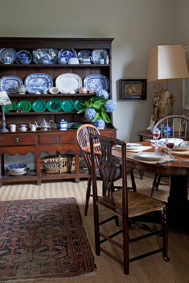An early 18th-century Welsh oak dresser holds Majolica leaf plates and blue-and-white platters.   Photo: Simon Griffiths