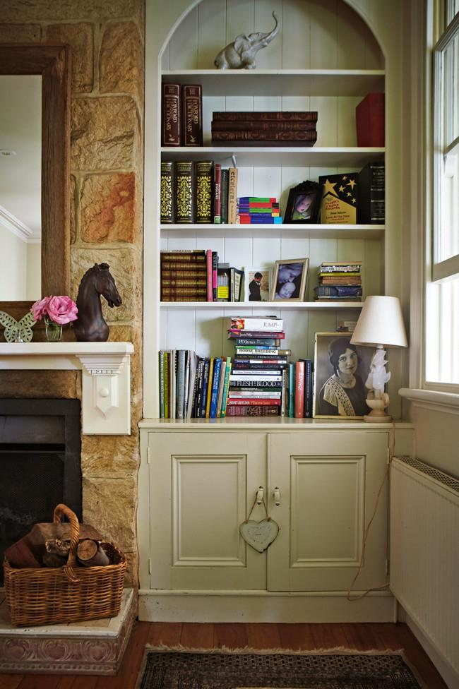 A portrait of Sarah's great-aunt Elsie takes pride of place on a bookcase. | Photo: Michael Wee