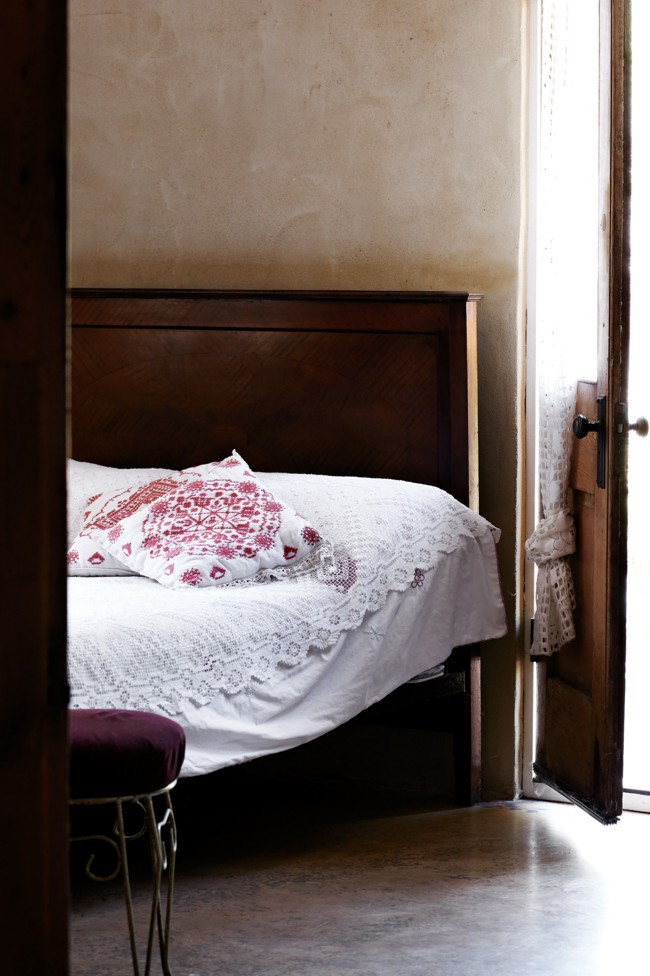 Some early 20th-century lacework and embroidery from Brittany in one of the bedrooms. | Photo: Sharyn Cairns