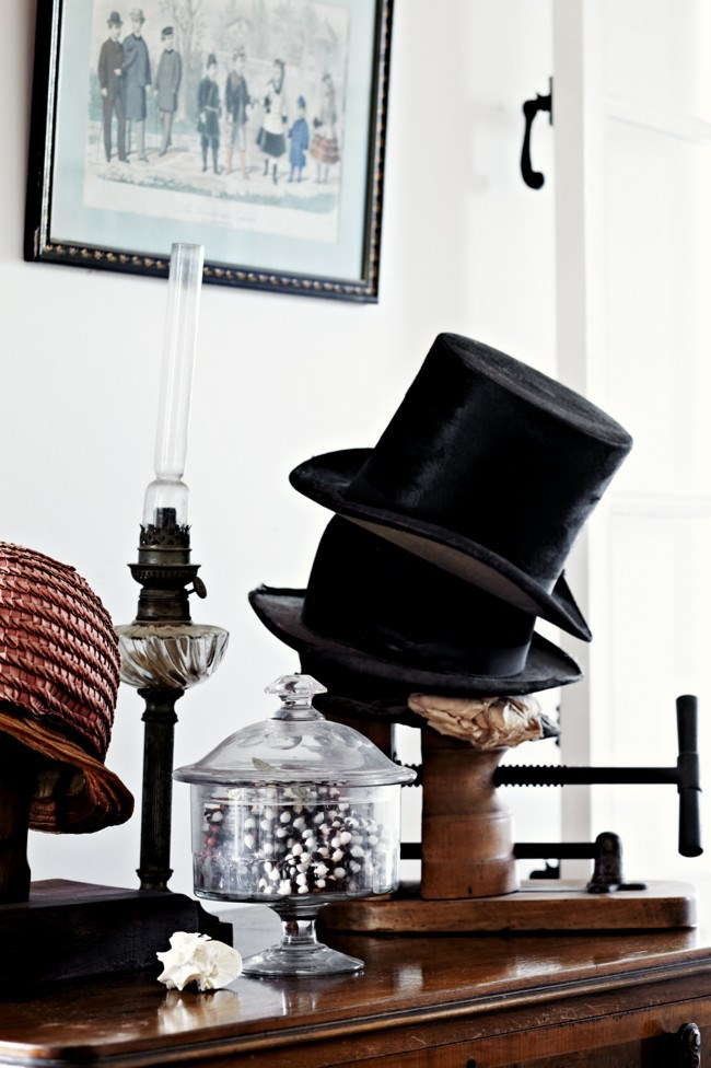 French hats piled on a vintage hat enlarger. | Photo: Sharyn Cairns