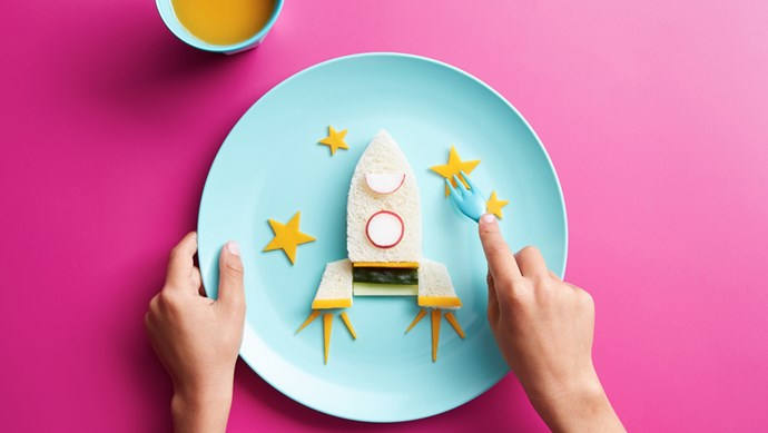 Houston, we have a meal. Everything tastes better when made with love. Composed of fruit, veggies, bread, cheese, pikelets and your careful handiwork, the kids will love these 11 creative dishes to the moon and back.  | Photo: Stocksy