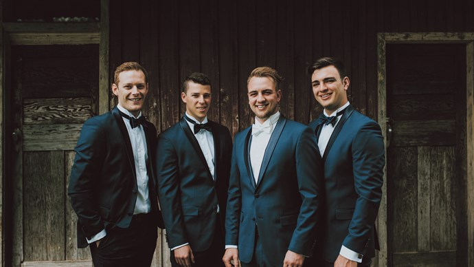 Paul smiles with his fellow architect groomsmen, and brother Dan (far right).    Photo: Feather and Birch Wedding Co