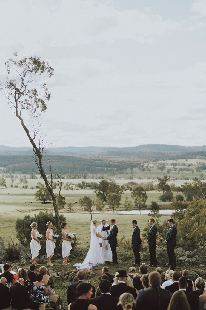 The creative pair levelled the proposal spot to convert it into an amphitheatre, and set up log pews six months before the big day to let them settle into the ground for their guests.    Photo: Feather and Birch Wedding Co