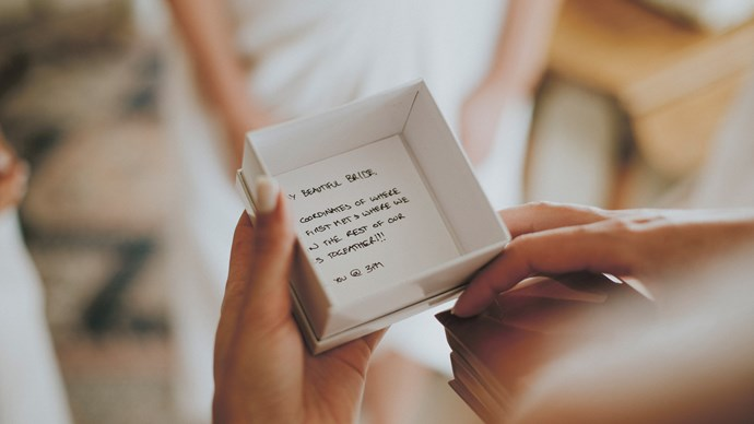 As the bride was getting ready, she received a jewellery box from her soon-to-be husband. Inside was a bracelet engraved with the latitude and longitude of the place they'd first met at university, as well as the coordinates of the ceremony location.    Photo: Feather and Birch Wedding Co