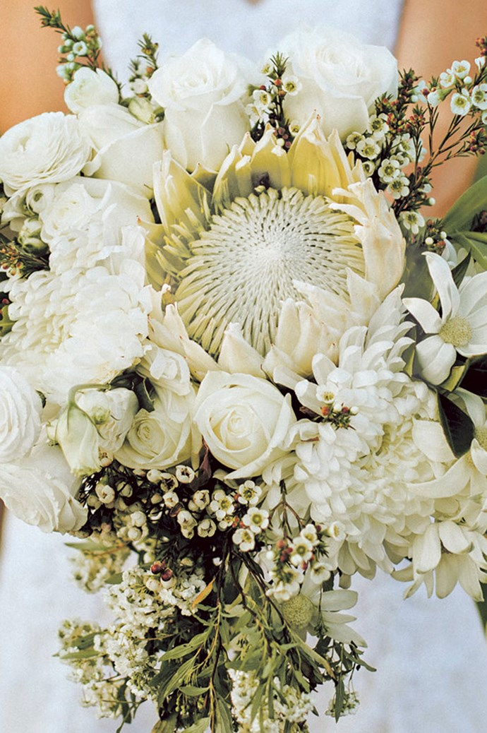 """""""The boys collected a ute full of flowers from a neighbour's garden the day before and we set about trimming them for bouquets, buttonholes and decorations,"""" says Lou.   Photo: Feather and Birch Wedding Co"""