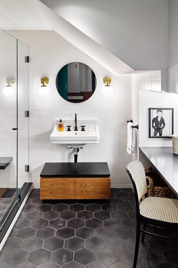 Pristine white splashback meets charcoal tiling.  | Photo: Architectural Digest
