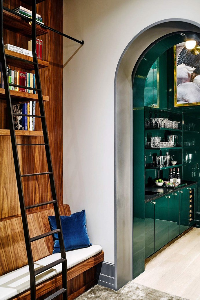 She and Schrieber study their scripts in the library, which conveniently connects to the in-house bar.  | Photo: Architectural Digest