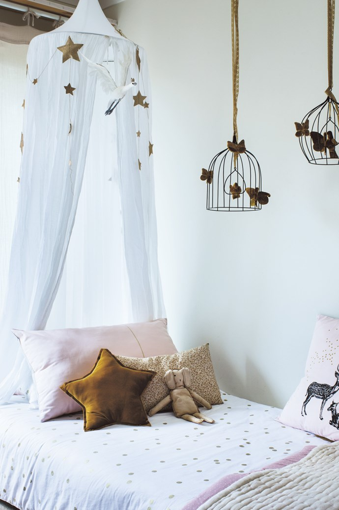 """""""My daughter is really in love with the canopy in her bedroom, which gives her a sense of comfort – that little extra element to feel nurtured – as well as the cushions. She often presses the little velvet gold star to her heart in bed,"""" says Eglantine."""