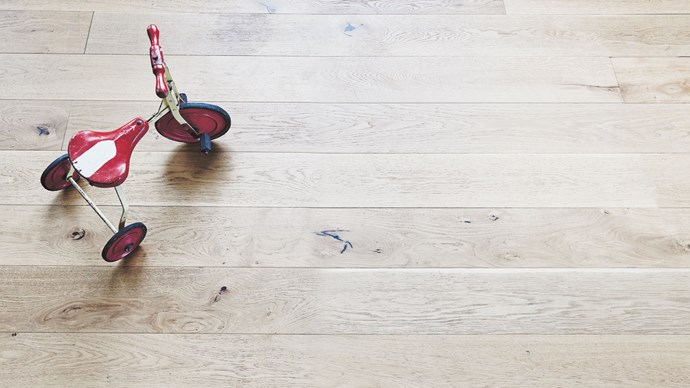 So those gleaming wooden floorboards you lovingly laid are starting to resemble a drag-racing track? Don't despair, there are solutions.  Unauthorised use of scooters and tricycles indoors (not to mention dog claws and high heels) wreak havoc on wooden floorboards. We understand. While a bit of wear and tear gives timber floors and tables charm, kids and pets can be particularly brutal on them. If you want to take the scuff level down, first make sure you're cleaning your floors with appropriate products for your kind of wood (check with the manufacturer).  For minor scratches, try rubbing a little baking soda mixed with water over the mark: baking soda is a mild abrasive. Spraying some WD-40 and buffing it might also work, although this will make your floor slippery, so do it after Nanna visits. If you've already got a magic eraser for your walls, try that too.   Deep scratches in solid wood floors require more effort; lightly sand and clean the scratch with mineral turpentine, then apply wood putty, sand again, and seal with polyurethane (ask at your hardware store for these products). | Photo: Lisa Cohen