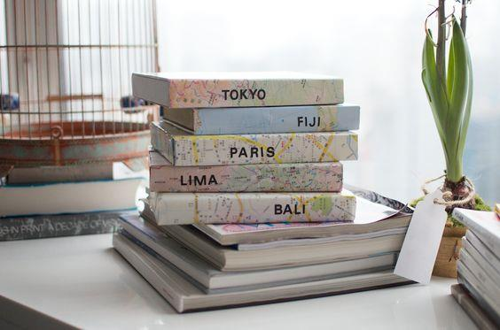 Customise travel boxes. Using maps to wrap old shoe or storage boxes makes for an eye-catching way to store ticket stubs, photos and trinkets from travels past. Store on a bookshelf to be seen instead of hiding away in cupboards to be forgotten. Image: [A Pair and a Spare DIY](http://apairandasparediy.com/)