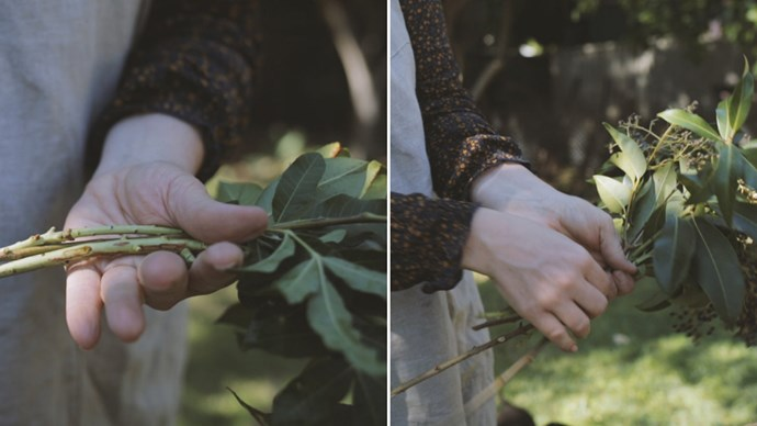 Begin with your greenery to create your base shape. Keep spinning the bunch around in your hand, holding with your left and adding new stems with your right.  | Photo: The Refuge Collective
