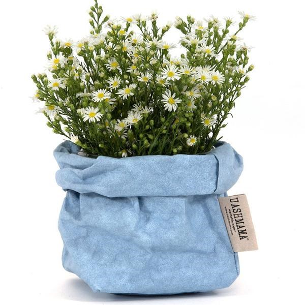 Once your standard buddy for grocery shopping, paper bags have evolved to become washable (like leather) and stylishly hand-sewn by Tuscan artisans. They're also adorable planters, available from [Uashmama](https://www.uashmama.com.au/collections/paper-bags/products/paper-bag-indigo).