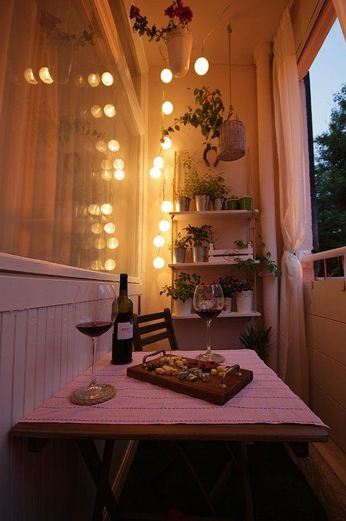 9\. Make it a night-time nook. If you've tried everything and the sun is simply too harsh for you or your plants outside, transform your space into a night-time retreat. That way once the sun goes down, it's your time to shine. Image via [Style and Cheek](http://styleandcheek.com/)