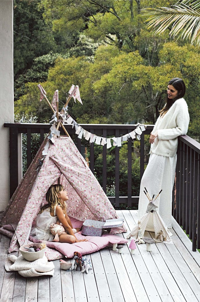 """Ninon often spends her days in a fabric teepee, which can be set up at whim in the living room, on the deck or hidden in the garden. """"I put a little futon on the bottom to make it cosy and she'll play for hours in there,"""" says Eglantine. 