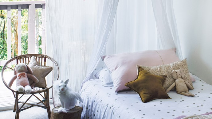 French-born designer Eglantine Velin, now a Sydney-based mum, believes in captivating indoors and out within a child's bedroom. Accents of rose pink and gold in linen and accessories help her daughter Ninon's room feel soothing and sweet.  | Photo: Brigid Arnott