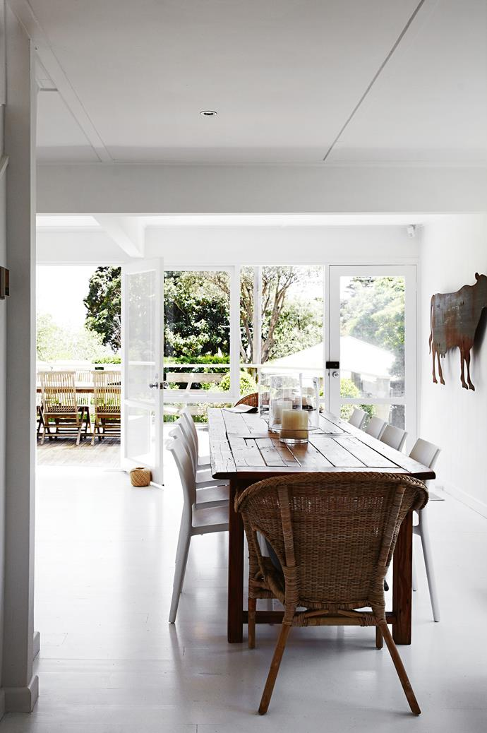 """In the dining room is a cow silhouette by a local metalworker, which hangs behind the table made from an old barn door. The hurricane candle holders are from South Yarra's [Home & Abroad](http://www.homeandabroad.com.au/