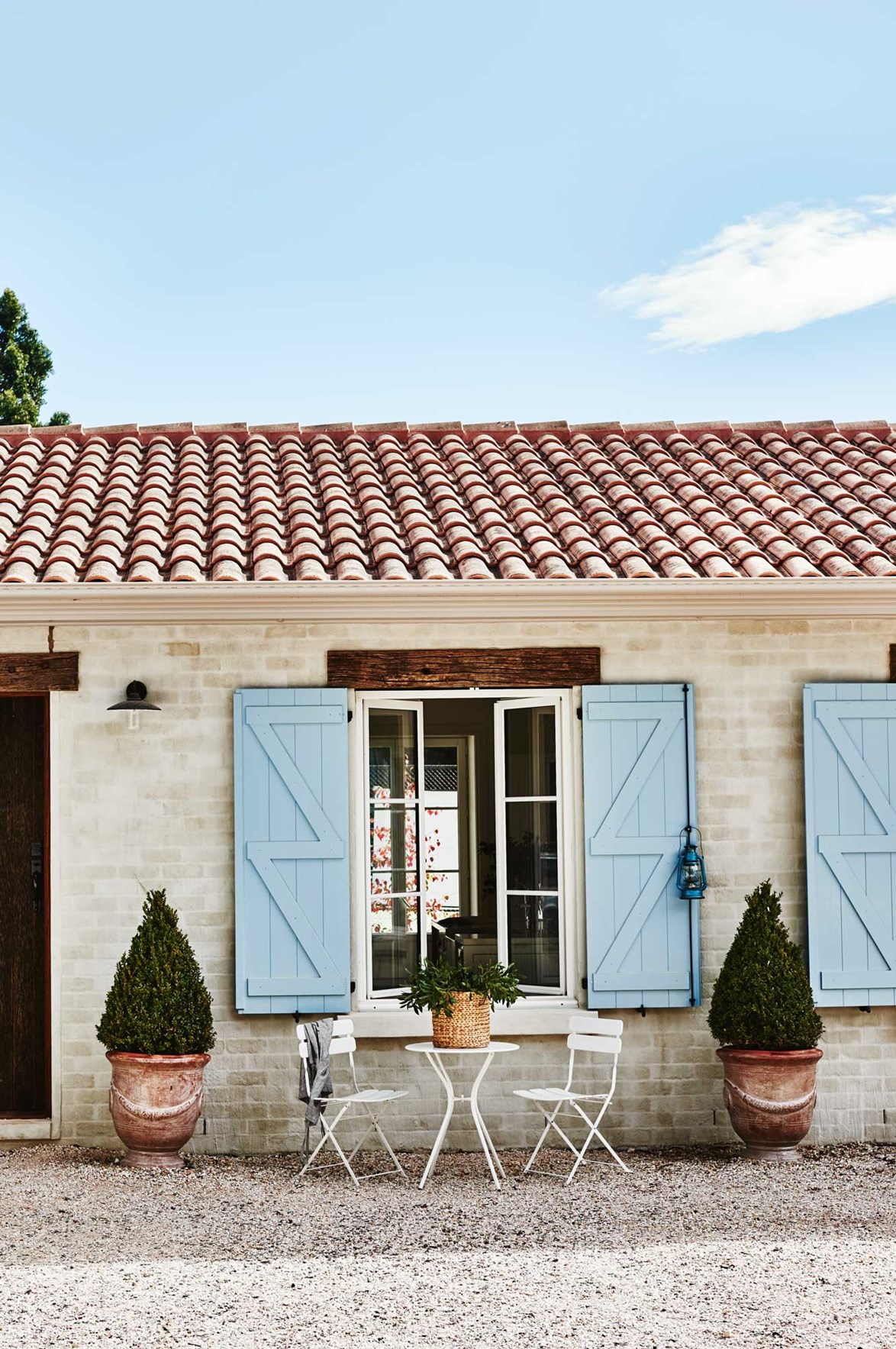 Determined to recreate the look of a French farmhouse, Narelle and Andrew quickly settled on their choice of blue window shutters.