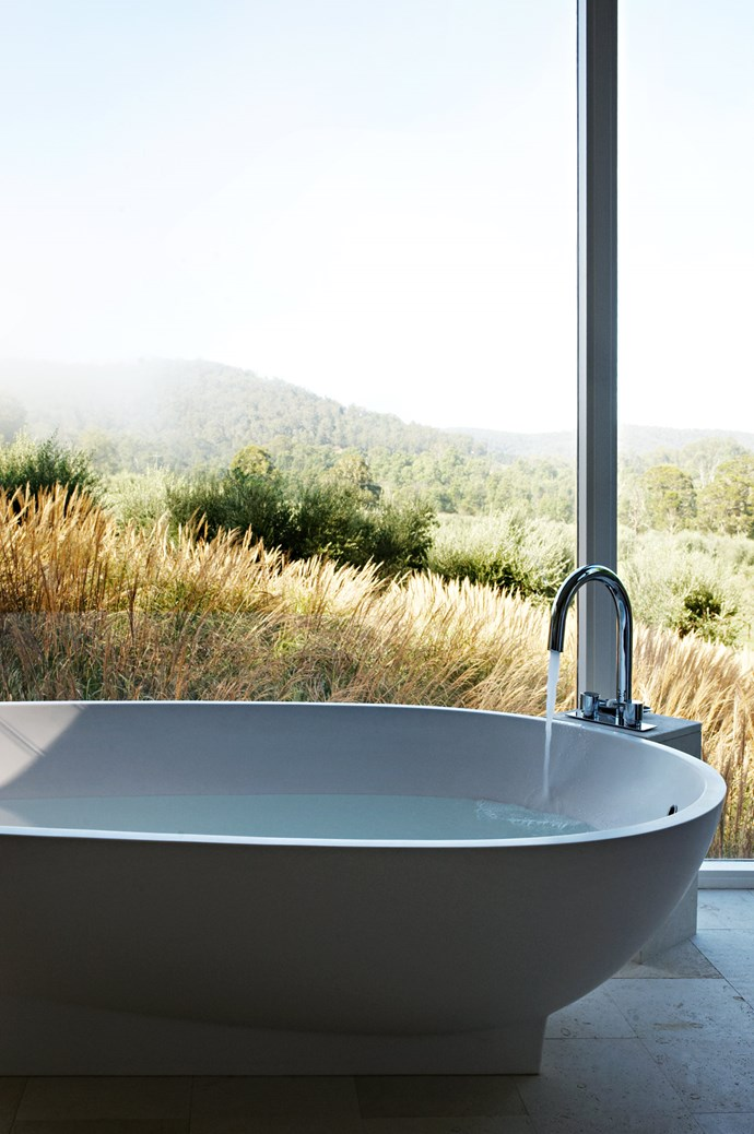 """[Views from the bathroom](https://www.homestolove.com.au/bathrooms-with-views-19407 target=""""_blank"""") in the guesthouse designed by Pike Withers, overlook olive trees to the south. The luxurious 'Lucia' freestanding cast stone bath is from Moda."""