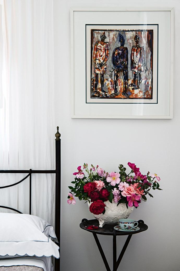 An artwork above the bedside table by Joe Furlonger depicts Pulcinella, who symbolises Armando's birth city of Naples.