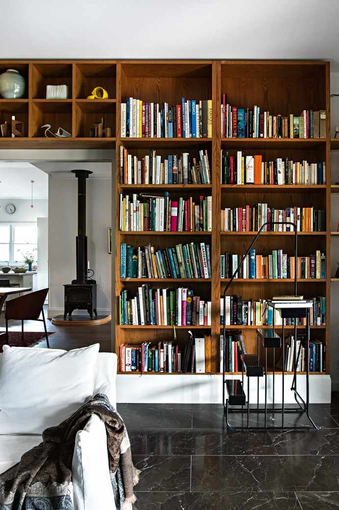 """The couple's [home library](https://www.homestolove.com.au/best-home-library-designs-3504 target=""""_blank"""") includes cookbooks by friends including Shannon Bennett, Neil Perry and Tetsuya Wakuda."""