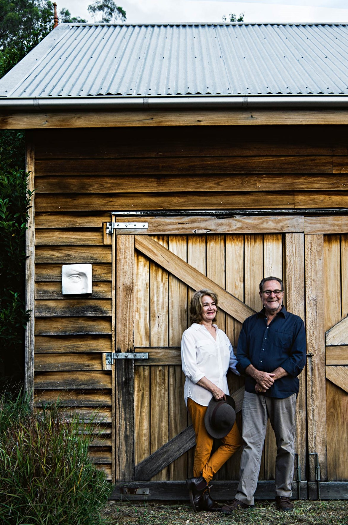 "Gemma and Armando, the owners of this [Hunter Valley weekender](https://www.homestolove.com.au/australian-farmhouse-design-13830|target=""_blank""), stand outside the barn at where they store vats of olive oil for bottling and labelling."