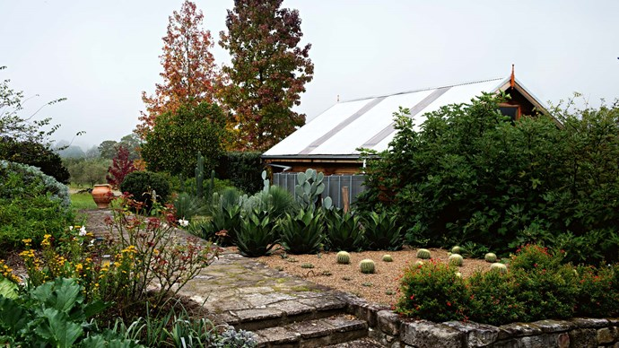 """[Landscape designer Michael Cooke](https://www.homestolove.com.au/sue-and-brians-park-style-country-garden-2375 target=""""_blank"""") helped create a garden that features Armando's sculpture collection as well as fruit, vegetables and herbs."""