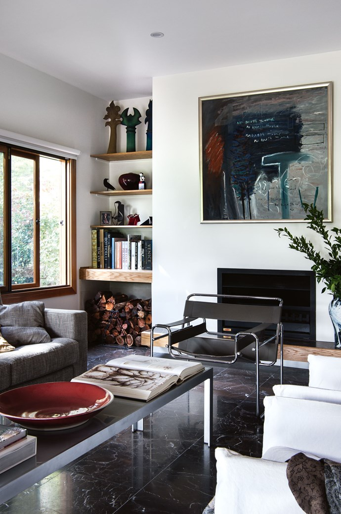 In the living room, a painting by Wendy Stokes overlooks a Monica Armani coffee table. The room is laid with Morato Etrusco honed marble flooring from Artedomus.